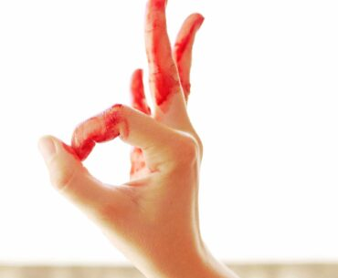 Hand with period blood